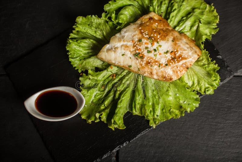 Grilled pangasius with sauce. Seafood. Fish dish. Restaurant stock photos