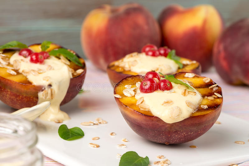 Grilled peaches dessert. Close up of delicious Grilled peaches dessert stock photography