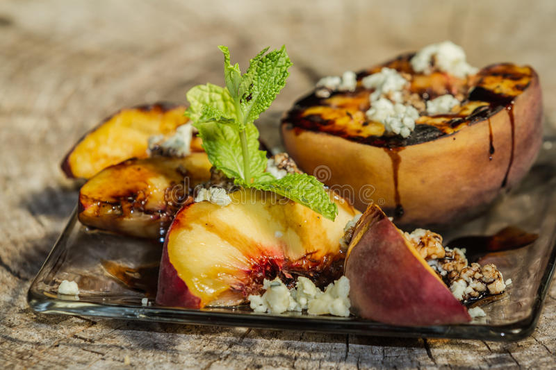 Grilled peaches royalty free stock images