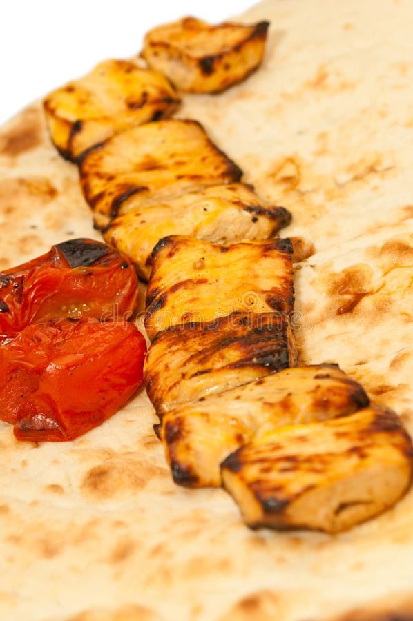 Grilled Pieces Of Chicken And Tomatoes Stock Photo