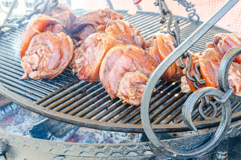 Grilled pork on barbecue grill royalty free stock images
