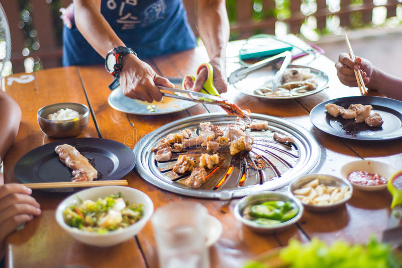 Grilled pork barbecue korean style in restaurant. Cook royalty free stock photo