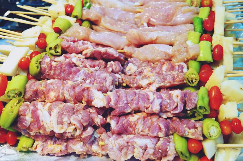 Grilled pork and Chicken barbecue in wood stick royalty free stock image
