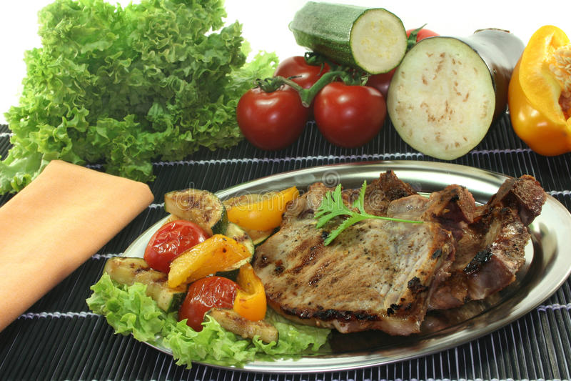 Grilled pork chop stock image