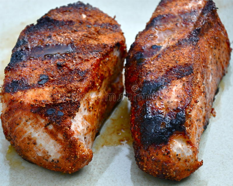 Grilled Pork Chops. Juicy pork chops fresh off the grill. Focus near top-front, with slight depth of focus royalty free stock photos