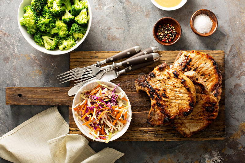 Grilled pork chops with cole slaw salad royalty free stock photo