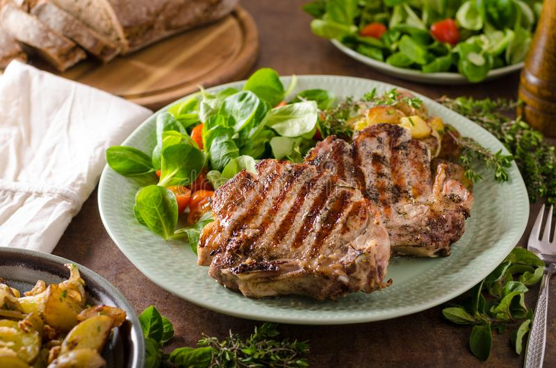 Grilled pork chops stock image