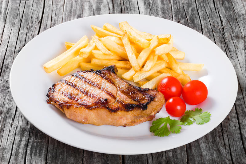 Grilled Pork Chops On A White Dish, Close-up Stock Photo - Image of ...