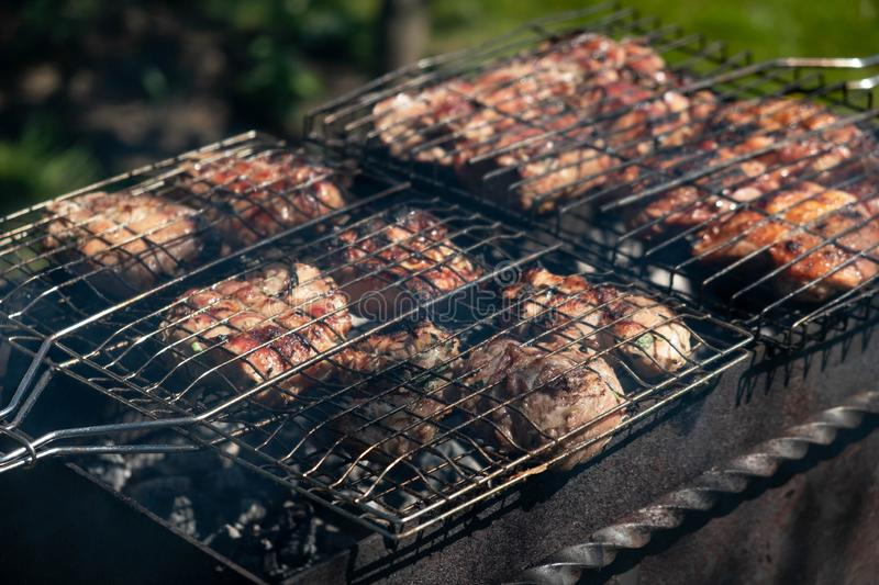 Grilled pork are cooked outdoors, summer picnic royalty free stock photography