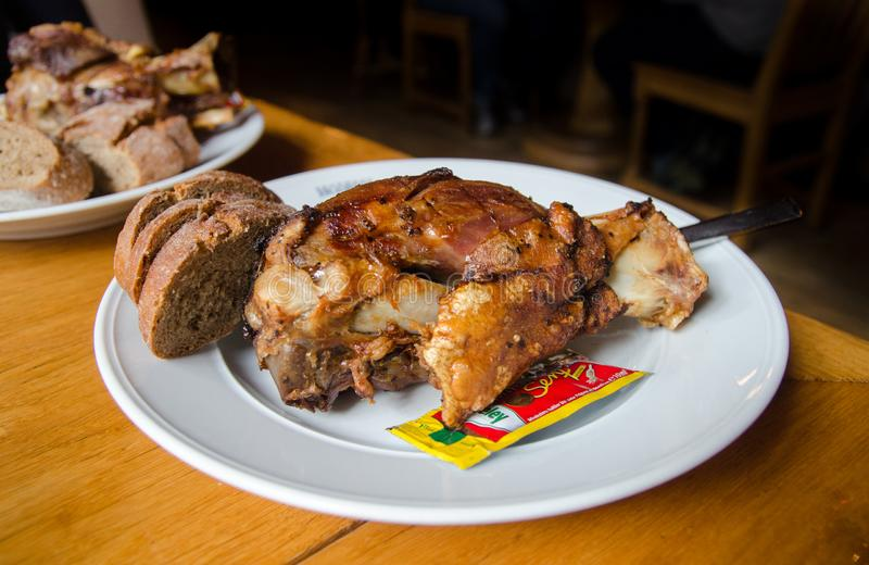 Grilled pork hock or pork knuckle served on white plate royalty free stock images