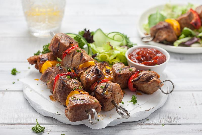 Grilled pork kebab with pepper. Grilled pork kebab with red and yellow pepper stock photos