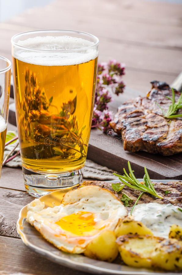 Grilled pork meat with beer stock photo