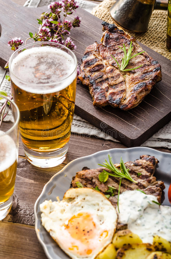 Grilled pork meat with beer royalty free stock photo