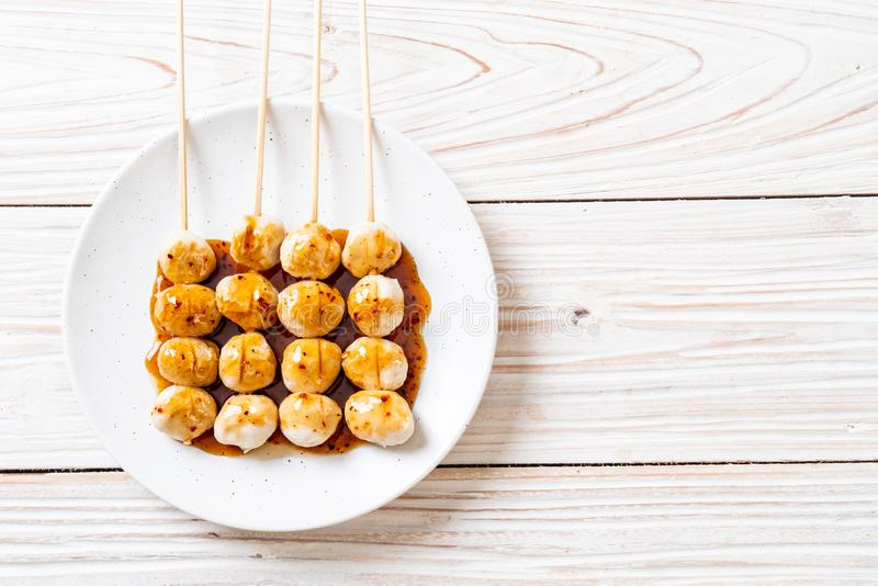 Grilled pork meatballs with sweet chili sauce. On plate royalty free stock photos