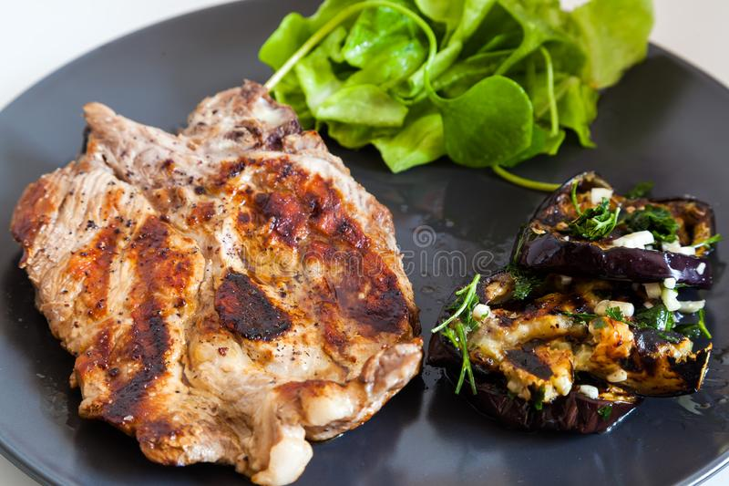 Grilled pork neck with egg plant. Shot of grilled pork neck with egg plant stock photos