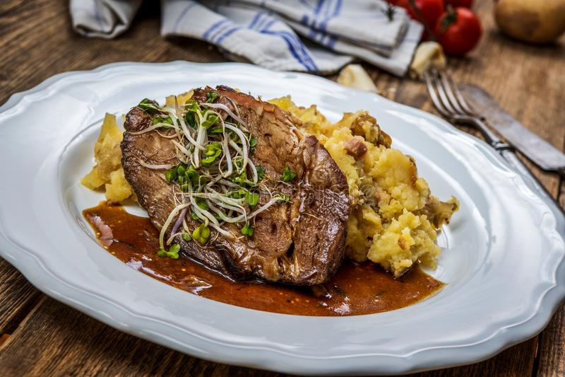 Grilled pork neck. With mashed potatoes and bacon stock images