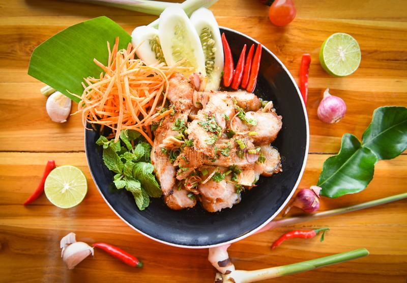 Grilled Pork Salad Thai food served on table with herbs and spices ingredients - Tradition northeast food Isaan delicious with stock photos