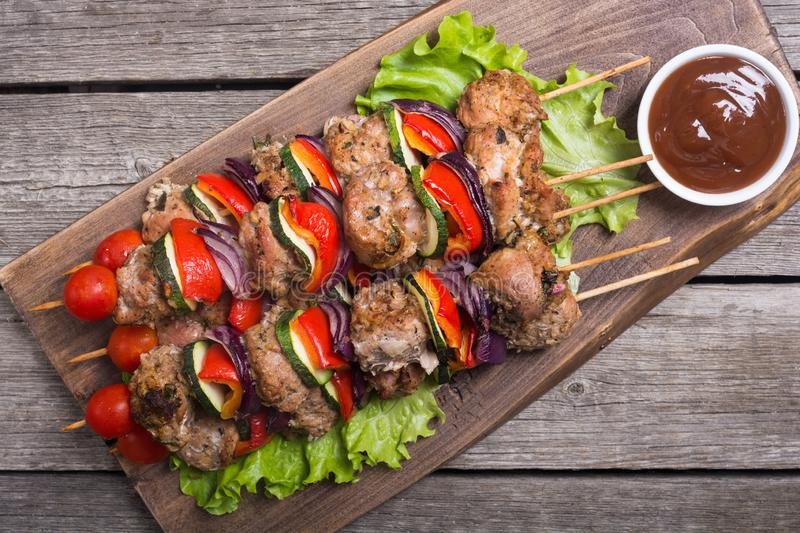 Grilled pork shish or kebab on skewers royalty free stock photography