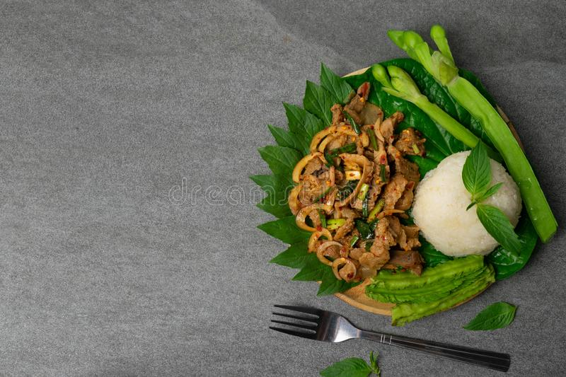 Grilled pork spicy salad with vegetables of northeast Thailand food or Lao food stock photography