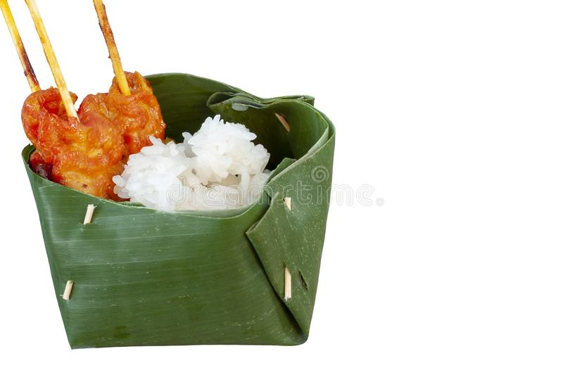 Grilled pork with sticky rice in natural made container easy to degrade to reduce the use of plastic. stock images