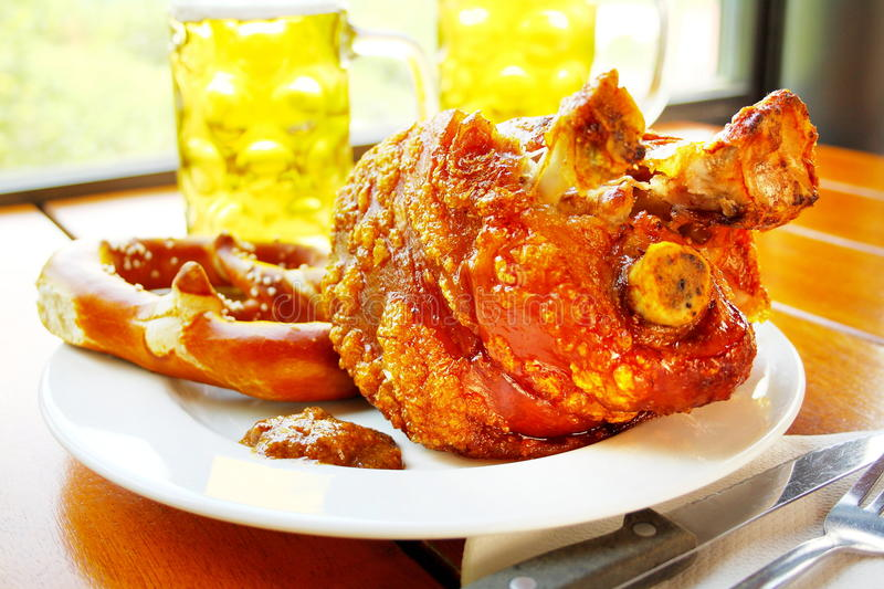Grilled pork with sweet mustard, pretzels and beer royalty free stock photography