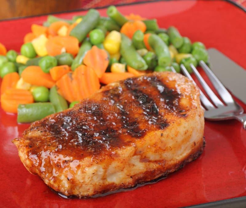 Pork Tenderloin. Grilled pork tenderloin meal on a plate stock images