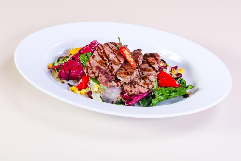 Grilled pork with vegetables stock photo