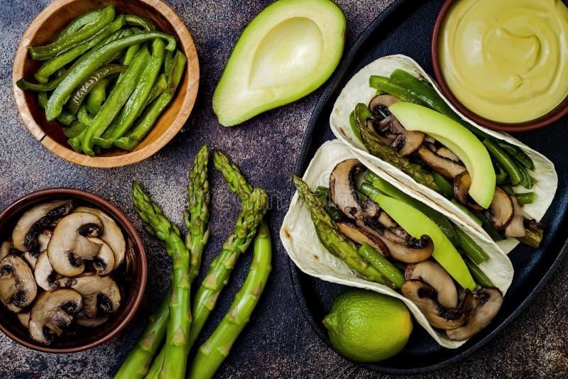 Grilled portobello, asparagus, bell peppers, green beans fajitas. Poblano mushroom tacos with jalapeno, cilantro, avocado crema. Vegan tacos with green summer royalty free stock photo