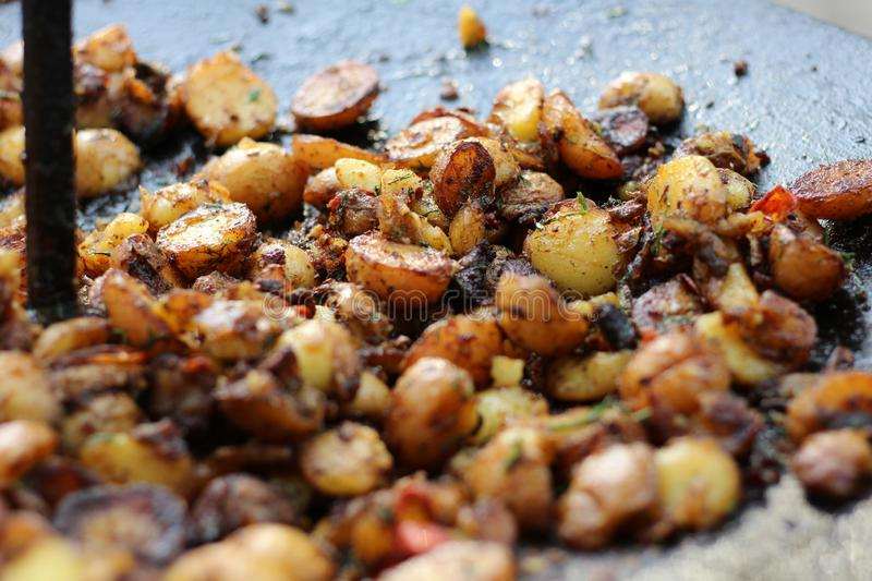 Grilled potatoes on the grill, camping stock photo