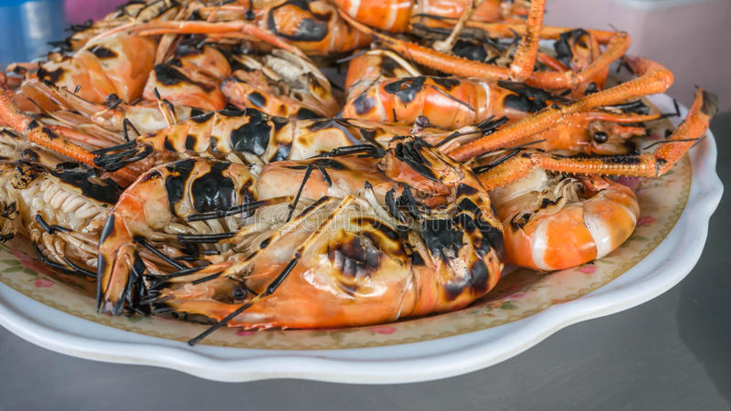 Grilled prawns on dish. Shirmp grilled on plate ready to be serve stock image