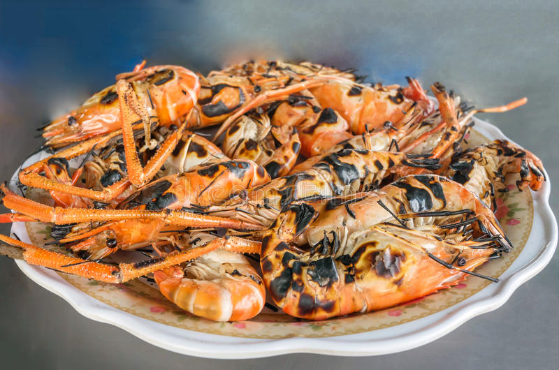 Grilled prawns on dish. Shirmp grilled on plate ready to be serve royalty free stock images