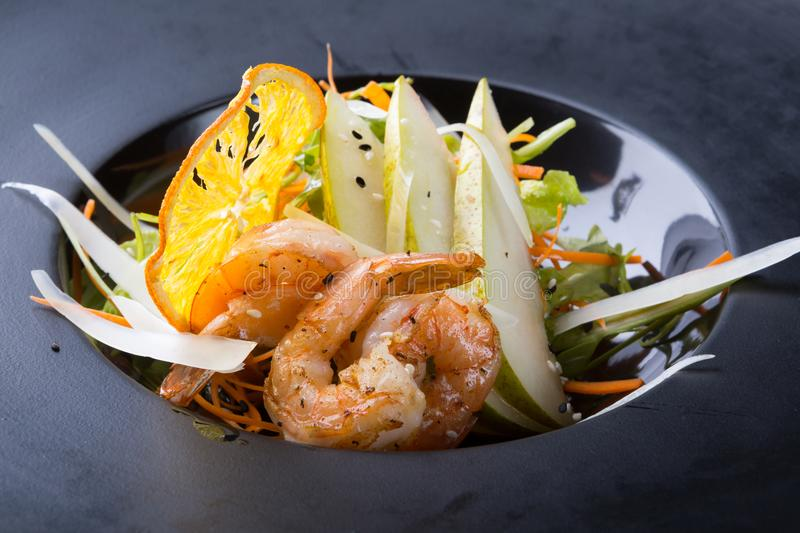 Shrimp salad served with pears stock images