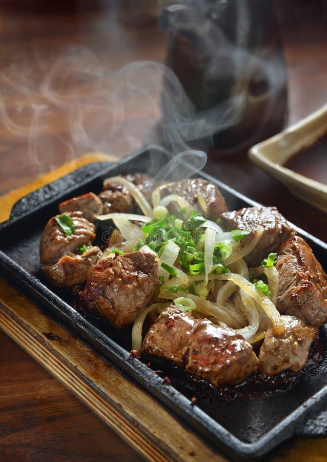 Beef steak hot pan. Grilled prime beef steak on hot pan stock images