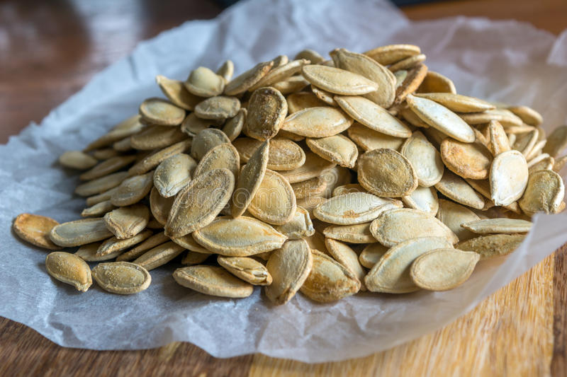 Grilled Pumpkin seeds with sea salt and spices royalty free stock photography