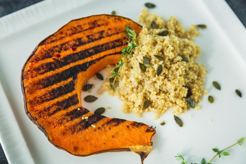 Grilled pumpkin with sprouted millet and pumpkin grains. Grilled pumpkin with sprouted millet and pumpkin grain stock photography