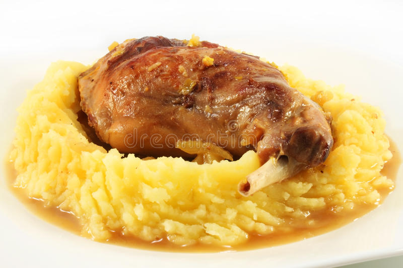 Grilled rabbit and mashed potatoes royalty free stock images