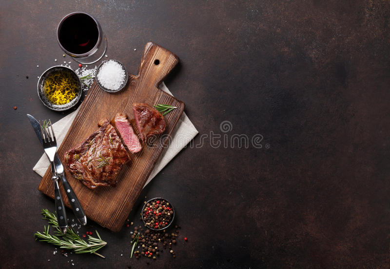 Grilled ribeye beef steak with red wine, herbs and spices. Top view with copy space for your text stock photos