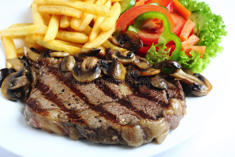 Grilled ribeye steak dinner stock photos