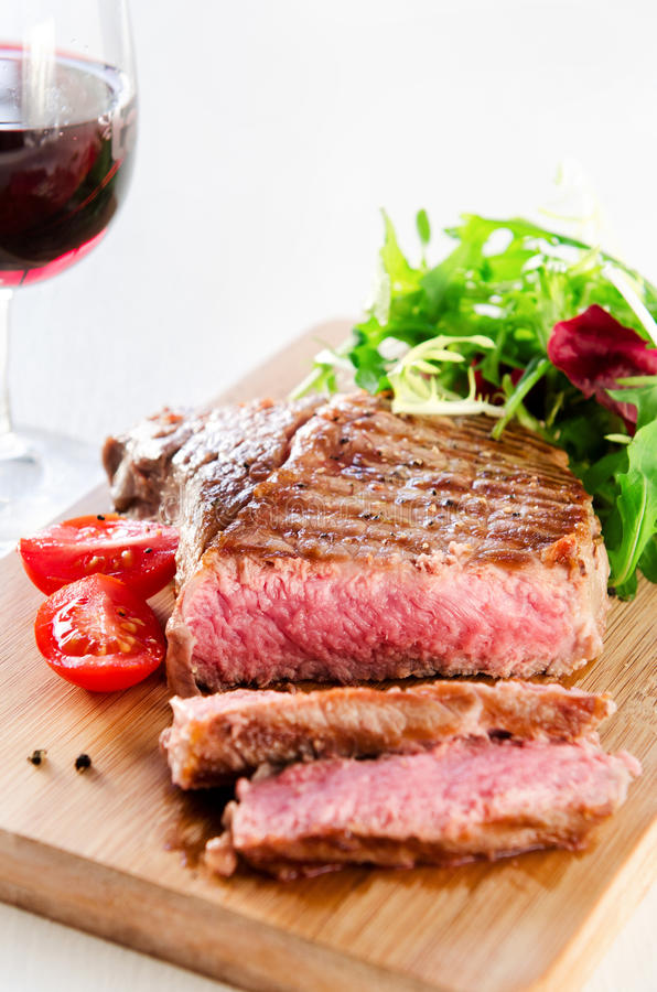 Grilled ribeye steak served with healthy salad stock photography