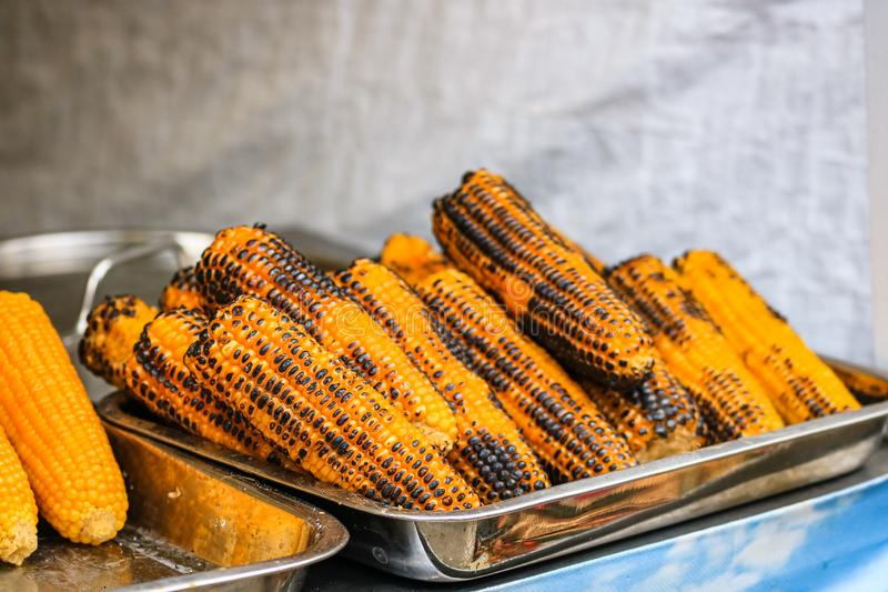 Grilled, roasted sweet corn ready to sell at a street food festival.  royalty free stock photography