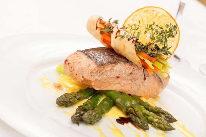 Grilled salmon and asparagus. Closeup royalty free stock images