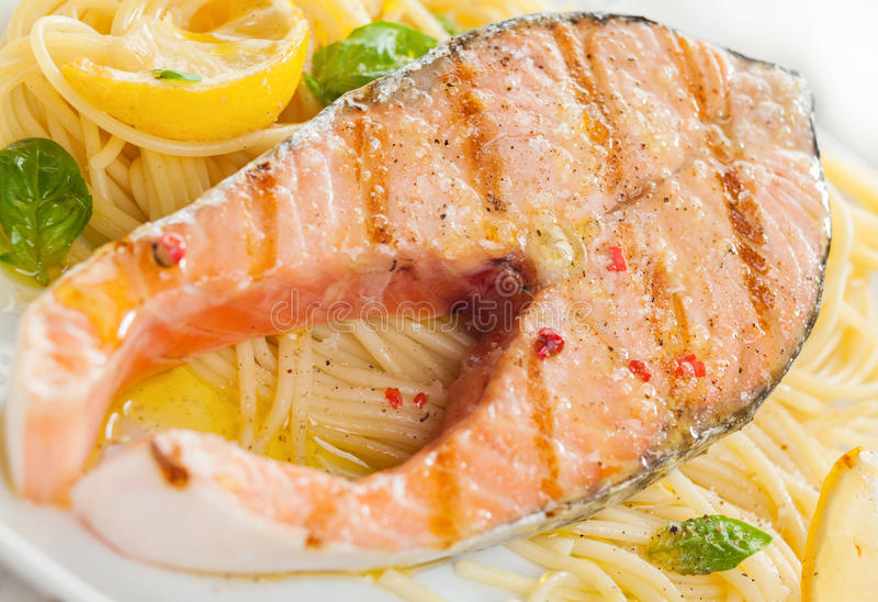 Grilled salmon cutlet with linguine pasta royalty free stock photography