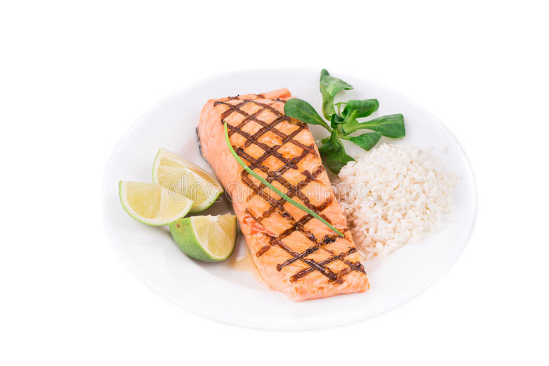 Grilled salmon filler with risotto. royalty free stock photo