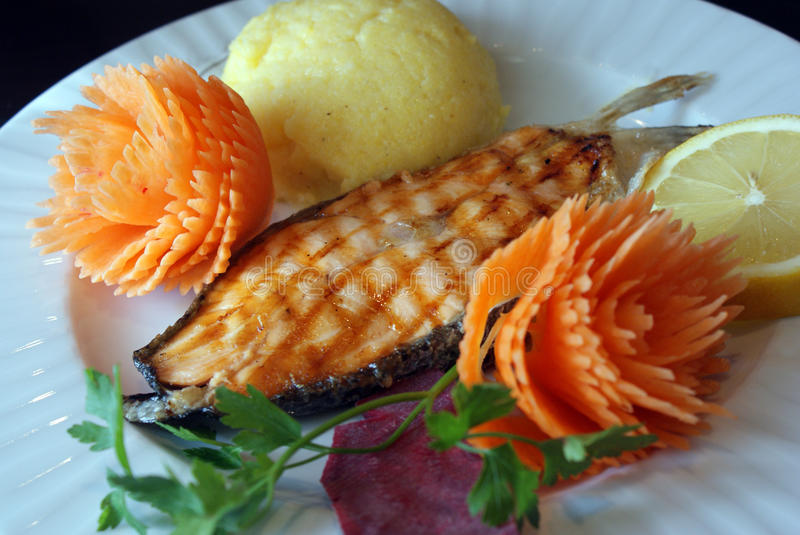 Grilled salmon with mamaliga stock image