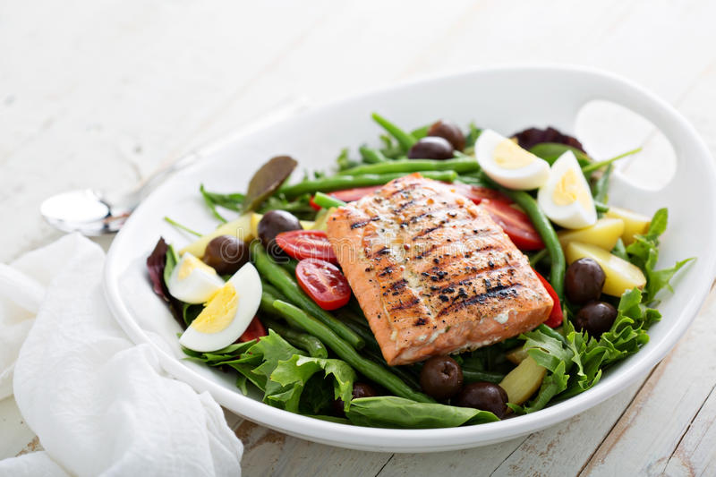 Grilled salmon nicoise salad stock images