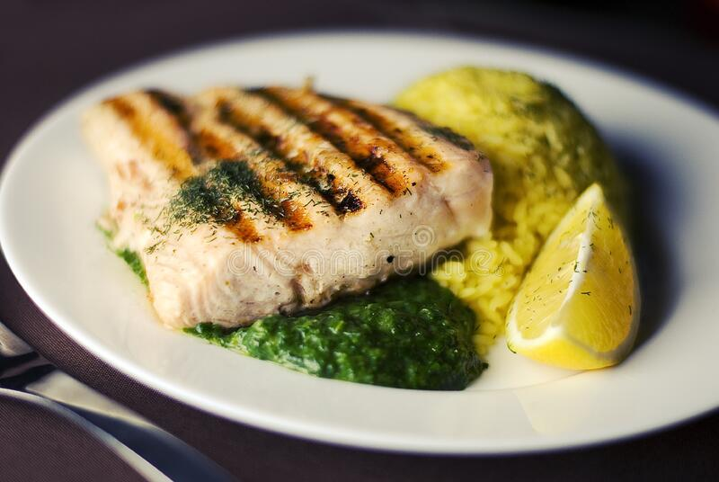 Grilled salmon plate royalty free stock photography