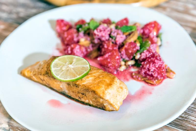 Grilled Salmon with raspberry royalty free stock photos