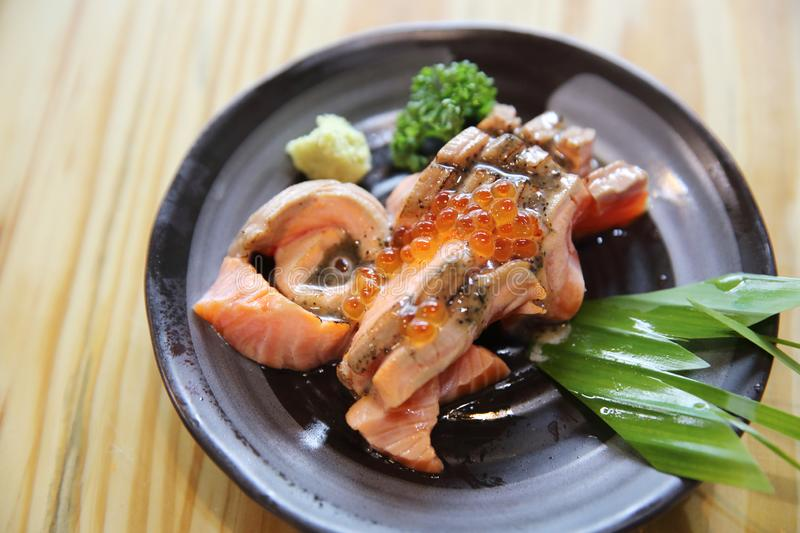 Grilled Salmon sashimi. On a plate royalty free stock image