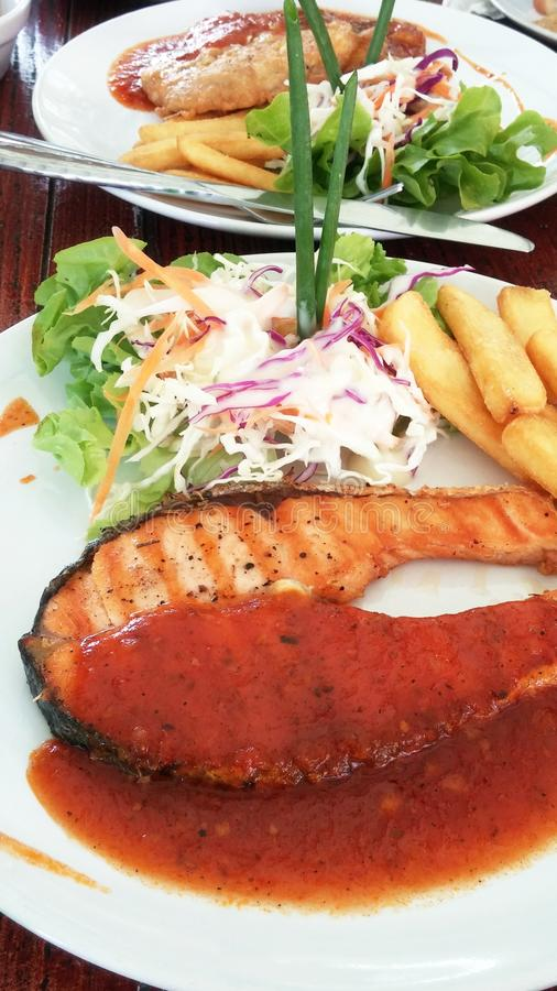 Grilled salmon with spicy and sweet sauce royalty free stock image