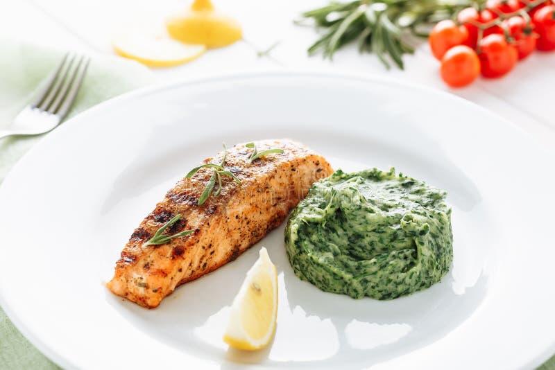 Grilled Salmon Steak Fillet Mash Potato Spinach stock image